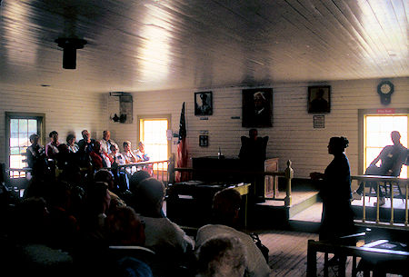 Courtroom (with tour group), Judge Wikersham Courthouse and Museum, Eagle, Alaska