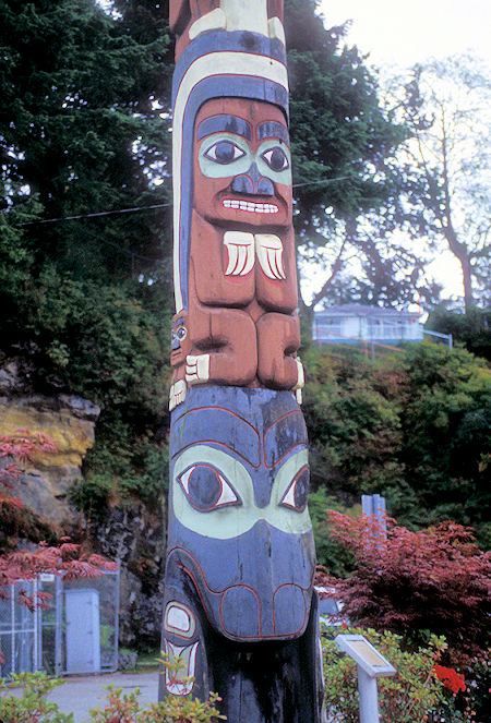 Chief's Totem Pole at Skedans with (bottom to top) a Killer Whale, Rainbow Person, Tcamaos (legendary creature that could roll-over canoes), Eagle and 3 Watchmen in Prince Rupert, British Columbia