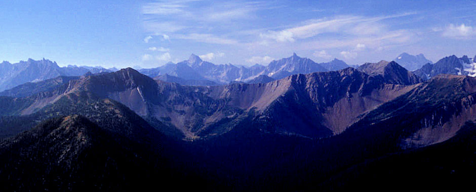 The Needles (left), Tower Mountain (middle left), Golden Horn Mountain (middle right), Black Peak (rear right) from 7,440' Slate Peak near Harts Pass, Washington