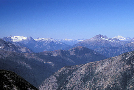 Snowfield Peak (left), Crater Mountain (right), Mt. Baker in distance on the right, from 7,440' Slate Peak near Harts Pass, Washington