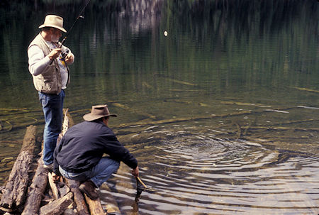 Whidbey Island print shop owner and Radio Shack owner hook a trout at Black Lake, Pasayten Wilderness, north of Winthrop, Washington