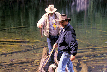 Whidbey Island print shop owner and Radio Shack owner land a trout at Black Lake, Pasayten Wilderness, north of Winthrop, Washington